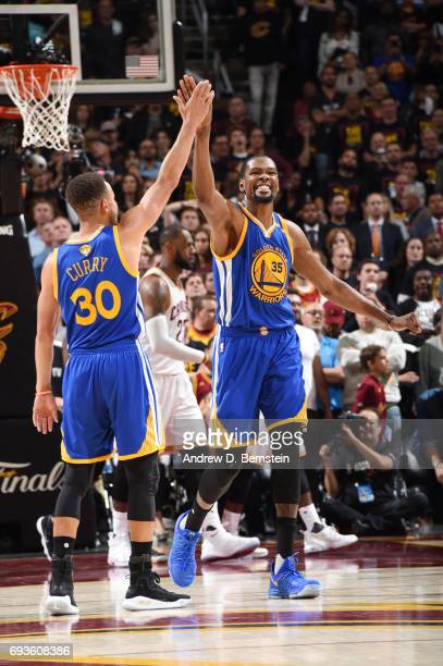 Stephen Curry and Kevin Durant of the Golden State Warriors celebrate in Game Three of the 2017 NBA Finals on June 7 2017 at Quicken Loans Arena in...