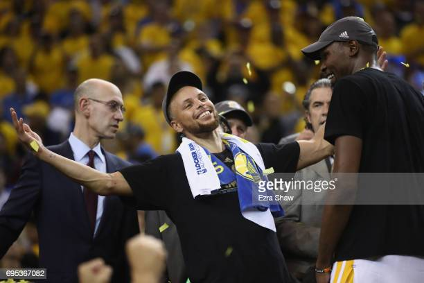 Stephen Curry and Kevin Durant of the Golden State Warriors celebrate after defeating the Cleveland Cavaliers 129120 in Game 5 to win the 2017 NBA...