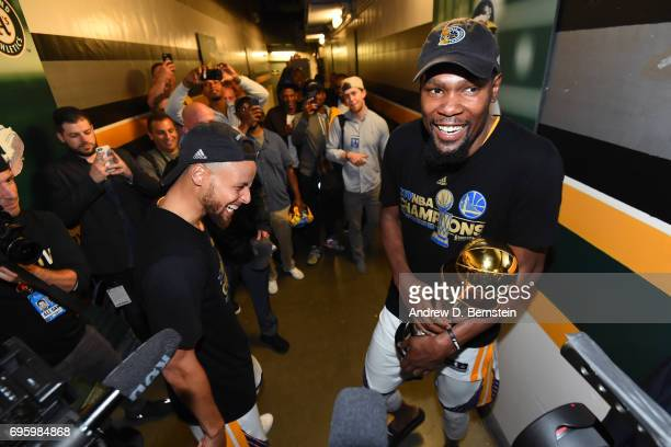 Stephen Curry and Kevin Durant of the Golden State Warriors celebrate together after winning the NBA Championshiop against the Cleveland Cavaliers in...