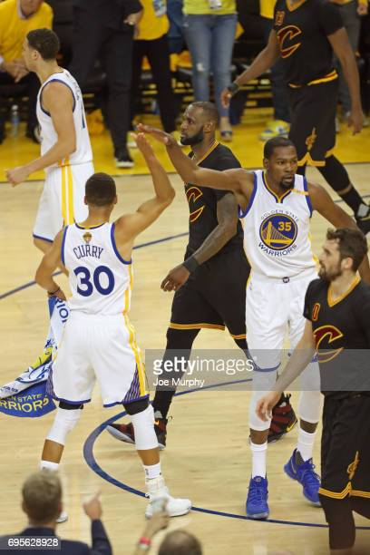 Stephen Curry and Kevin Durant of the Golden State Warriors high five in Game Five of the 2017 NBA Finals against the Cleveland Cavaliers on June 12...