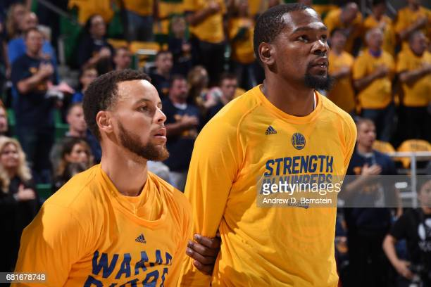 Stephen Curry and Kevin Durant of the Golden State Warriors honor the National Anthem before the game against the Utah Jazz during Game Four of the...