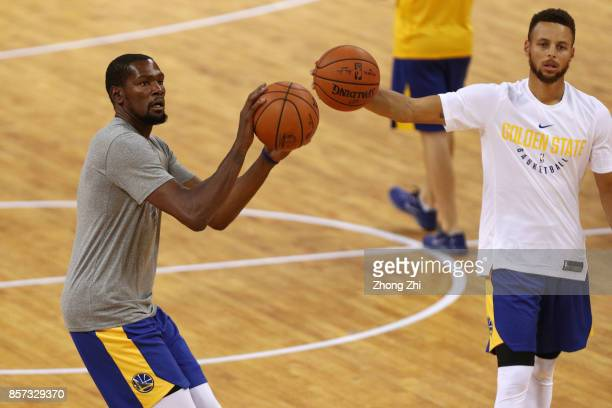 Stephen Curry and Kevin Durant of the Golden State Warriors in action during practice at Shenzhen Gymnasium as part of 2017 NBA Global Games China on...