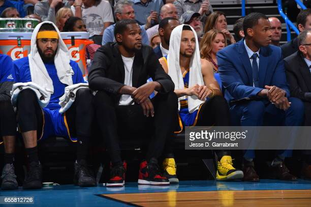 Stephen Curry and Kevin Durant of the Golden State Warriors look on against the Oklahoma City Thunder during the game on March 20 2017 at Chesapeake...