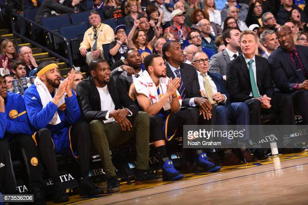 Stephen Curry and Kevin Durant of the Golden State Warriors look on during a game against the Memphis Grizzlies on March 26 2017 at ORACLE Arena in...