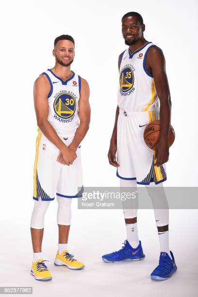 Stephen Curry and Kevin Durant of the Golden State Warriors pose for a portrait during media day on September 22 2017 at Oracle Arena in Oakland...