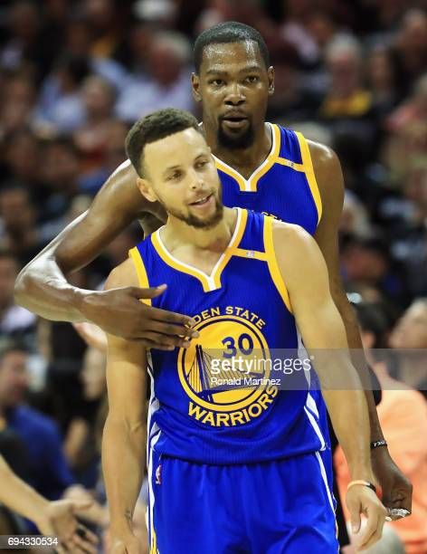 Stephen Curry and Kevin Durant of the Golden State Warriors react after a foul call in the first quarter against the Cleveland Cavaliers in Game 4 of...
