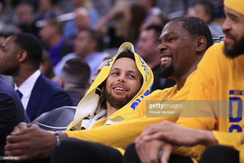 Stephen Curry #30 and Kevin Durant #35 of the Golden State Warriors react on the bench during the fourth quarter against the San Antonio Spurs during Game Three of the 2017 NBA Western Conference Finals at AT&T Center on May 20, 2017 in San Antonio, Texas.