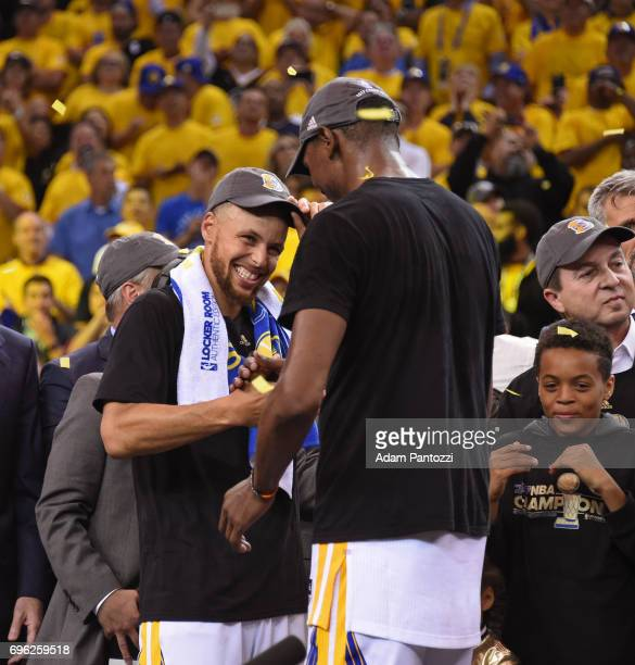 Stephen Curry and Kevin Durant of the Golden State Warriors shake hands on stage after winning Game Five of the 2017 NBA Finals against the Cleveland...