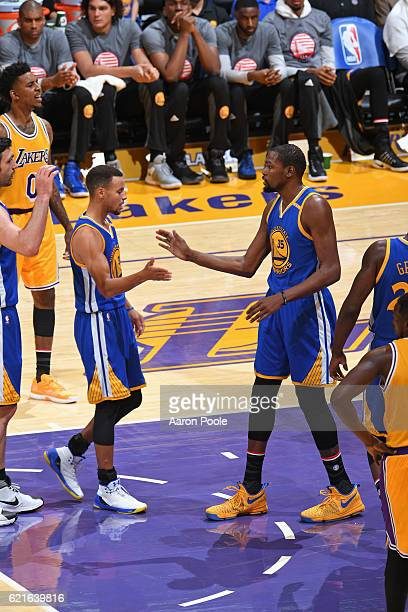 Stephen Curry and Kevin Durant of the Golden State Warriors shake hands during the game against the Los Angeles Lakers on November 4 2016 at STAPLES...