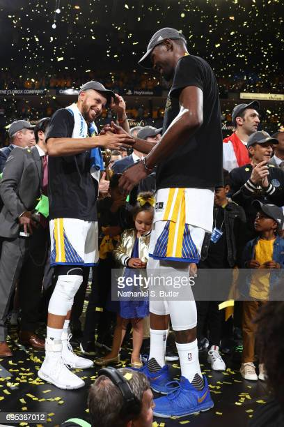 Stephen Curry and Kevin Durant of the Golden State Warriors shake hands after winning Game Five of the 2017 NBA Finals against the Cleveland...