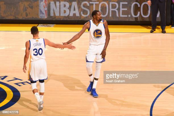 Stephen Curry and Kevin Durant of the Golden State Warriors shakes hands in Game Five of the 2017 NBA Finals against the Cleveland Cavaliers on June...