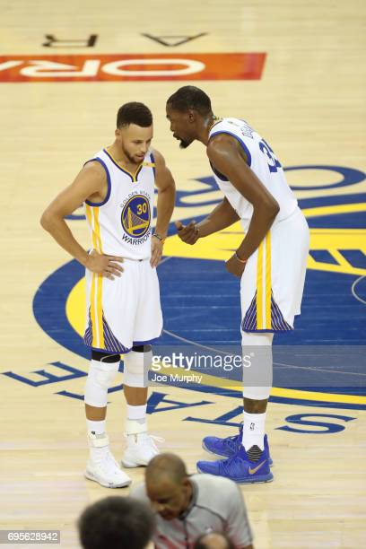 Stephen Curry and Kevin Durant of the Golden State Warriors talk in Game Five of the 2017 NBA Finals against the Cleveland Cavaliers on June 12 2017...