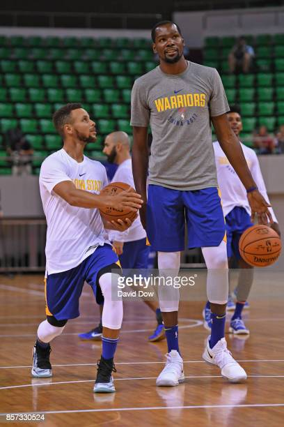 Stephen Curry and Kevin Durant of the Golden State Warriors talk during practice and media availability at Shenzhen Gymnasium as part of 2017 NBA...
