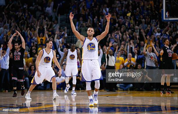 Stephen Curry and Klay Thompson of the Golden State Warriors celebrates after Harrison Barnes made a threepoint basket late in the fourth quarter of...