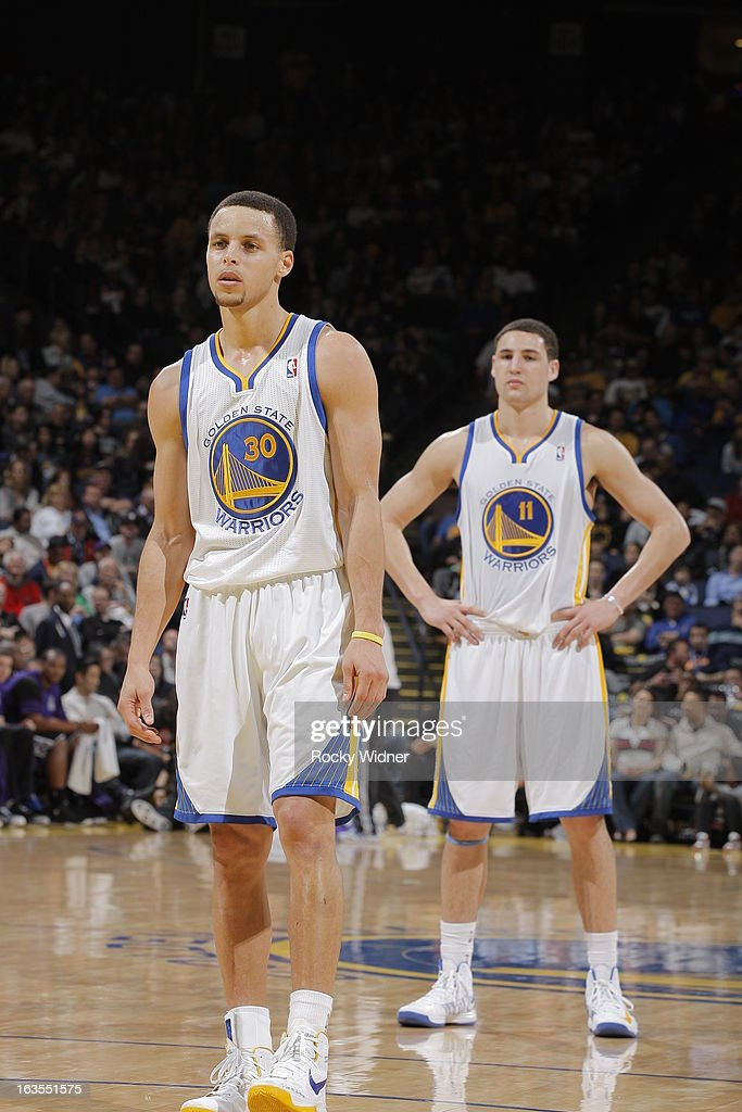 Stephen Curry #30 and Klay Thompson #11 of the Golden State Warriors in a game against the Sacramento Kings on March 6, 2013 at Oracle Arena in Oakland, California.