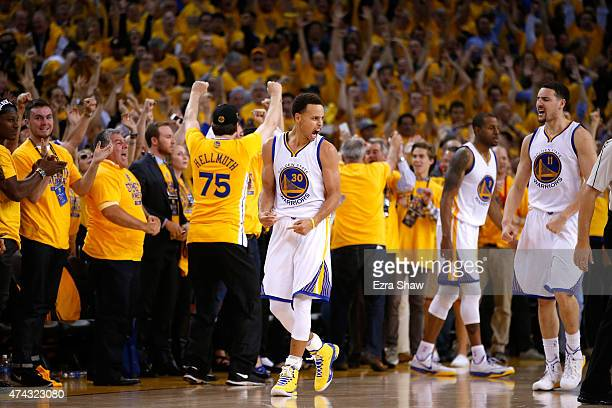 Stephen Curry and Klay Thompson of the Golden State Warriors react after defeating the Houston Rockets during game two of the Western Conference...