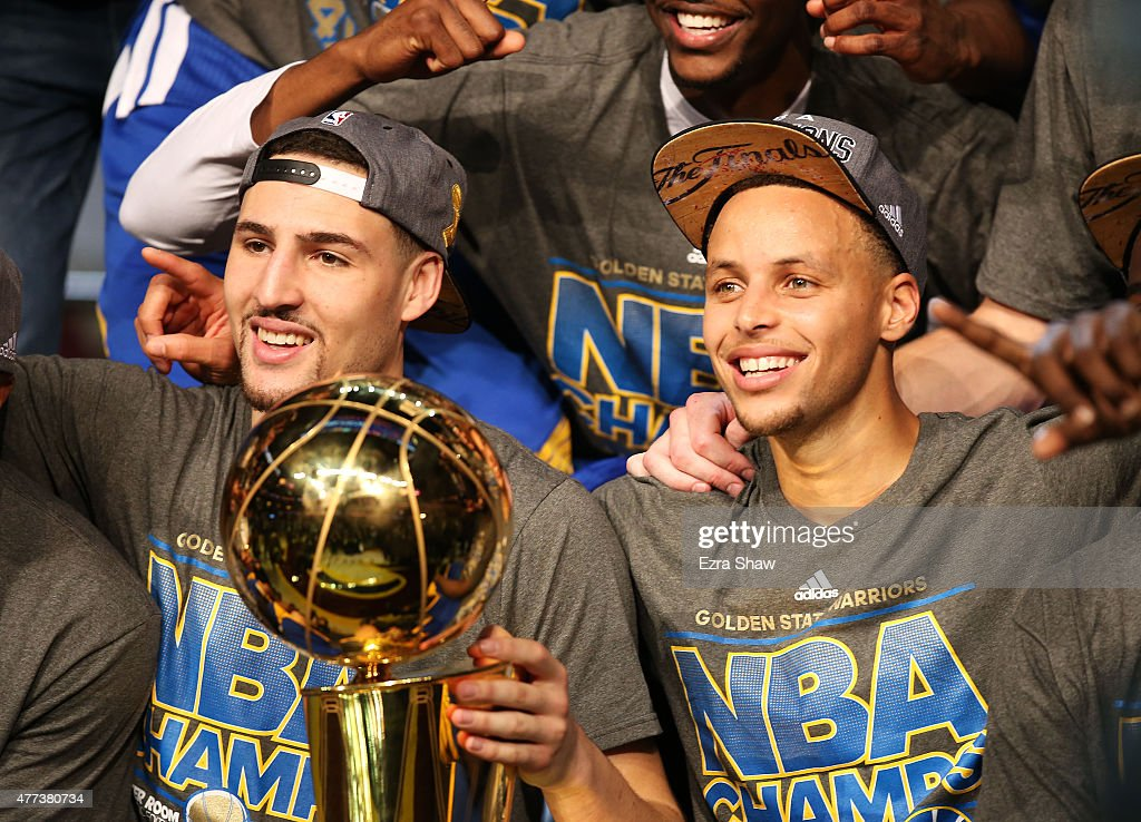 Stephen Curry and Klay Thompson of the Golden State Warriors celebrate with the Larry O'Brien NBA Championship Trophy after defeating the Cleveland...