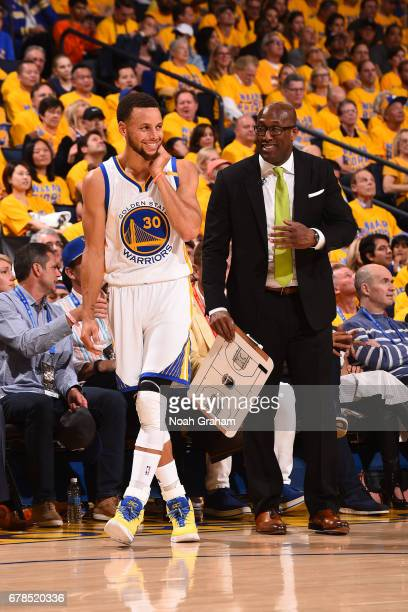 Stephen Curry and Mike Brown of the Golden State Warriors smile and talk during Game One of the Western Conference Semifinals against the Utah Jazz...