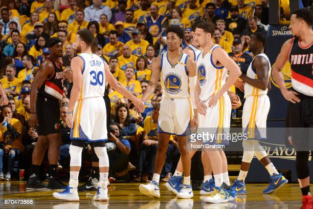 Stephen Curry and Patrick McCaw of the Golden State Warriors high five each other during the game against the Portland Trail Blazers during Game Two...