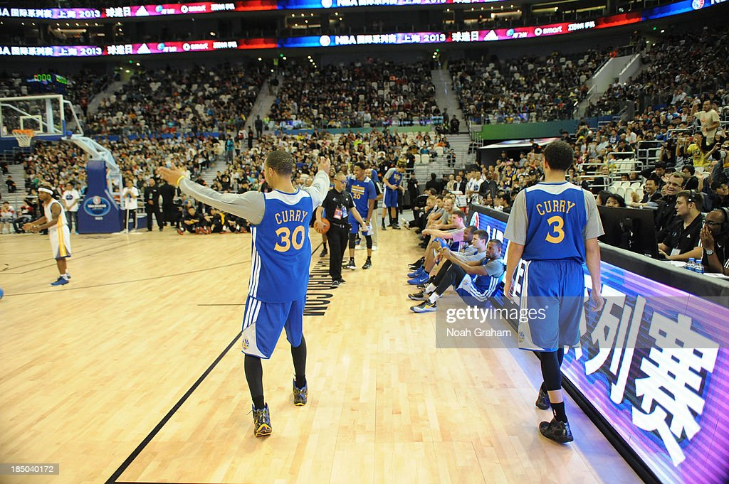 Stephen Curry and <a gi-track='captionPersonalityLinkClicked' href=/galleries/search?phrase=Seth+Curry&family=editorial&specificpeople=5945068 ng-click='$event.stopPropagation()'>Seth Curry</a> of the Golden State Warriors during Fan Appreciation Day as part of the 2013 Global Games on October 17, 2013 at the Oriental Sports Center in Shanghai, China.