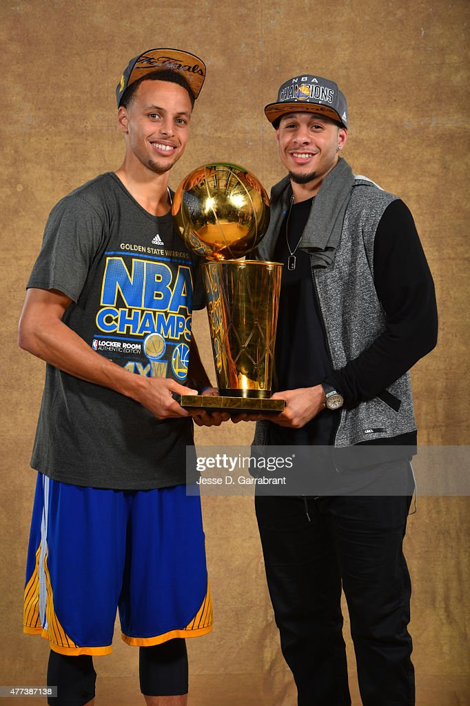 <a gi-track='captionPersonalityLinkClicked' href=/galleries/search?phrase=Stephen+Curry+-+Basketball+Player&family=editorial&specificpeople=5040623 ng-click='$event.stopPropagation()'>Stephen Curry</a> #30 and <a gi-track='captionPersonalityLinkClicked' href=/galleries/search?phrase=Seth+Curry&family=editorial&specificpeople=5945068 ng-click='$event.stopPropagation()'>Seth Curry</a> of the Golden State Warriors poses for a portrait with the Larry O'Brien trophy after defeating the Cleveland Cavaliers in Game Six of the 2015 NBA Finals on June 16, 2015 at Quicken Loans Arena in Cleveland, Ohio.