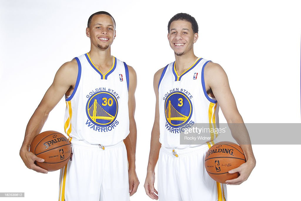 Stephen Curry #30 and <a gi-track='captionPersonalityLinkClicked' href=/galleries/search?phrase=Seth+Curry&family=editorial&specificpeople=5945068 ng-click='$event.stopPropagation()'>Seth Curry</a> #3 pose for a photo on Golden State Warriors media day held September 27, 2013 at the Warriors practice facility in Oakland, California.