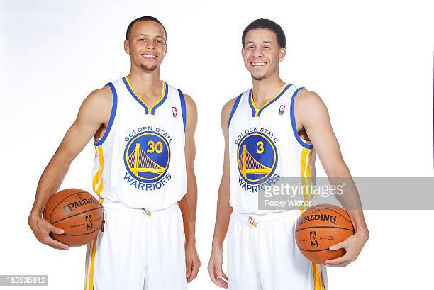 Stephen Curry and Seth Curry pose for a photo on Golden State Warriors media day held September 27 2013 at the Warriors practice facility in Oakland...