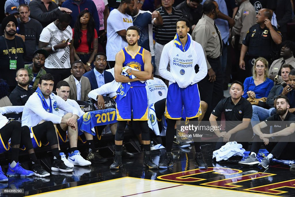 Stephen Curry #30 and Shaun Livingston #34 of the Golden State Warriors look on from the sideline late in the fourth quarter against the Cleveland Cavaliers in Game 4 of the 2017 NBA Finals at Quicken Loans Arena on June 9, 2017 in Cleveland, Ohio.