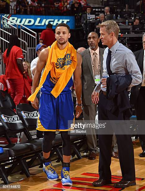 Stephen Curry and Steve Kerr of the Golden State Warriors talk after warming up during halftime of Game Four of the Western Conference Quarterfinals...