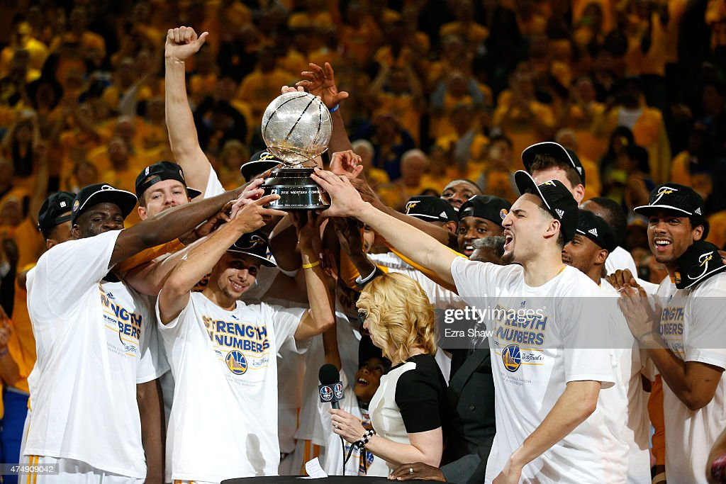 Stephen Curry #30 and the Golden State Warriors celebrate the Warriors 104-90 victory against the Houston Rockets during game five of the Western Conference Finals of the 2015 NBA Playoffs at ORACLE Arena on May 27, 2015 in Oakland, California.