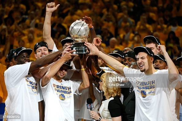 Stephen Curry and the Golden State Warriors celebrate the Warriors 10490 victory against the Houston Rockets during game five of the Western...