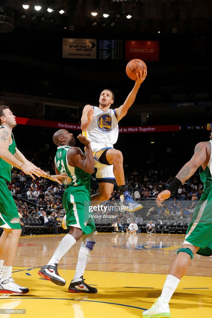 Stephen Curry #30 attempts a shot against Corry Carr #21 of the Maccabi Haifa on October 11, 2012 at Oracle Arena in Oakland, California.