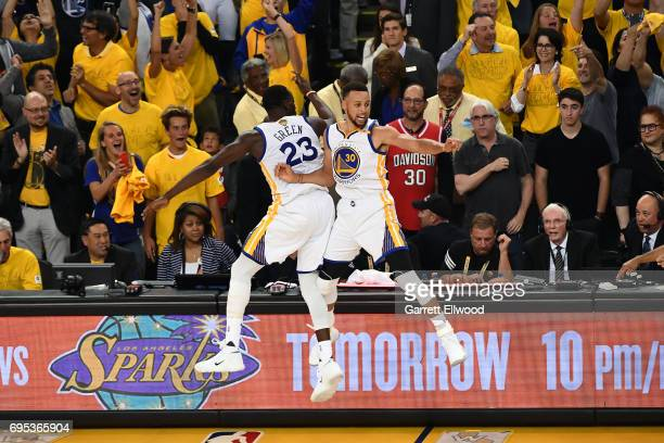 Stephen Curry celebrates with Draymond Green of the Golden State Warriors during the game against the Cleveland Cavaliers in Game Five of the 2017...