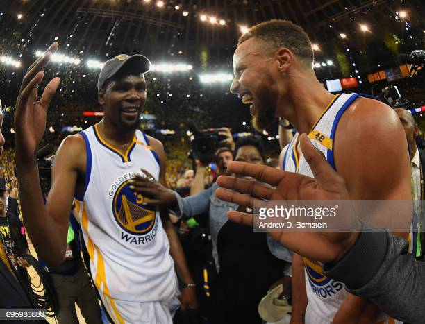 Stephen Curry celebrates with Kevin Durant of the Golden State Warriors after winning the NBA Championship against the Cleveland Cavaliers in Game...