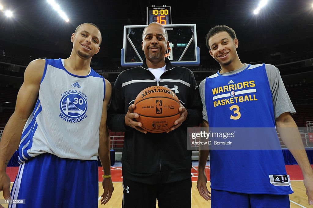 Stephen Curry #30, <a gi-track='captionPersonalityLinkClicked' href=/galleries/search?phrase=Dell+Curry&family=editorial&specificpeople=788171 ng-click='$event.stopPropagation()'>Dell Curry</a> and <a gi-track='captionPersonalityLinkClicked' href=/galleries/search?phrase=Seth+Curry&family=editorial&specificpeople=5945068 ng-click='$event.stopPropagation()'>Seth Curry</a> of the Golden State Warriors pose for a photo after practice as part of 2013 Global Games on October 14, 2013 at the MasterCard Center in Beijing, China.