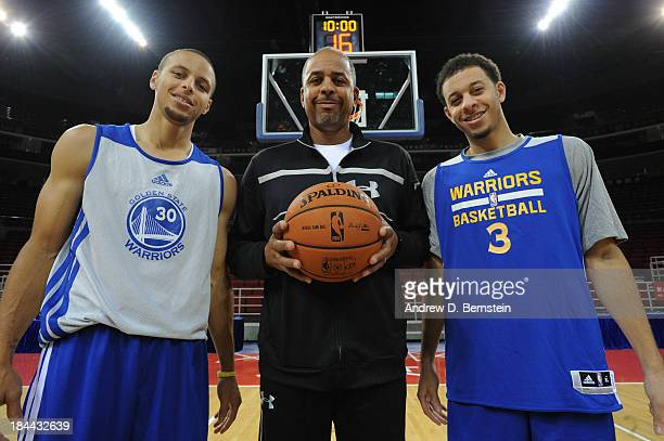 Stephen Curry Dell Curry and Seth Curry of the Golden State Warriors pose for a photo after practice as part of 2013 Global Games on October 14 2013...