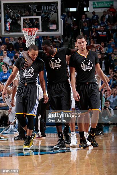 Stephen Curry Draymond Green and Klay Thompson of the Golden State Warriors huddle up against the Dallas Mavericks on December 13 2014 at the...