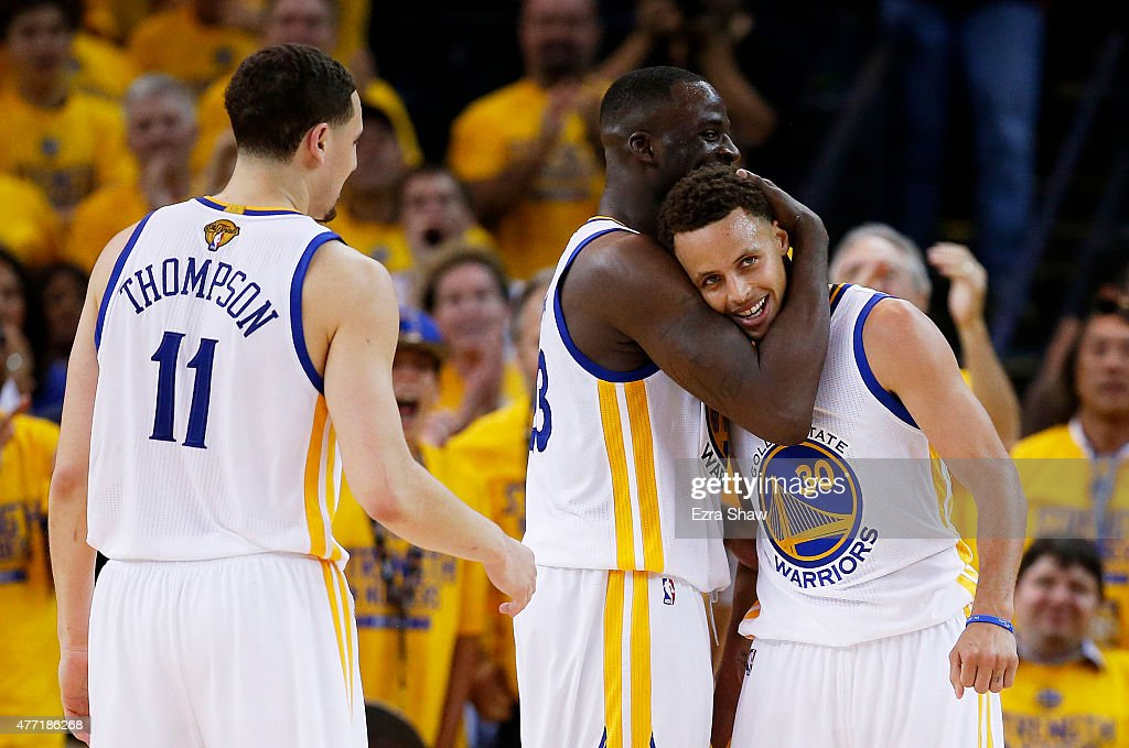 Stephen Curry Draymond Green and Klay Thompson of the Golden State Warriors celebrate late in their 109 to 91 win over the Cleveland Cavaliers during...