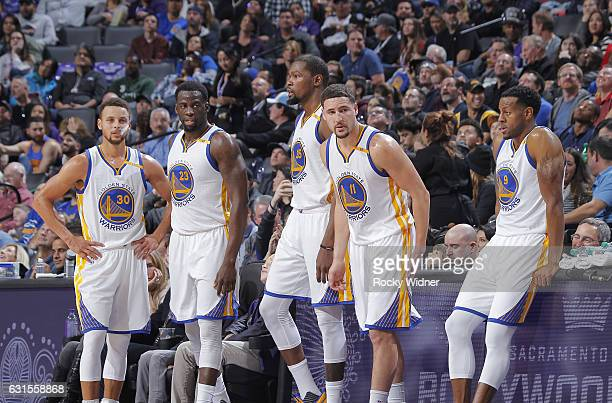 Stephen Curry Draymond Green Kevin Durant Klay Thompson and Andre Iguodala of the Golden State Warriors face off against the Sacramento Kings on...