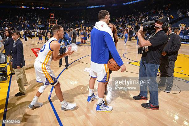 Stephen Curry dumps ice on Klay Thompson of the Golden State Warriors during his postgame interview after the game against the Indiana Pacers on...