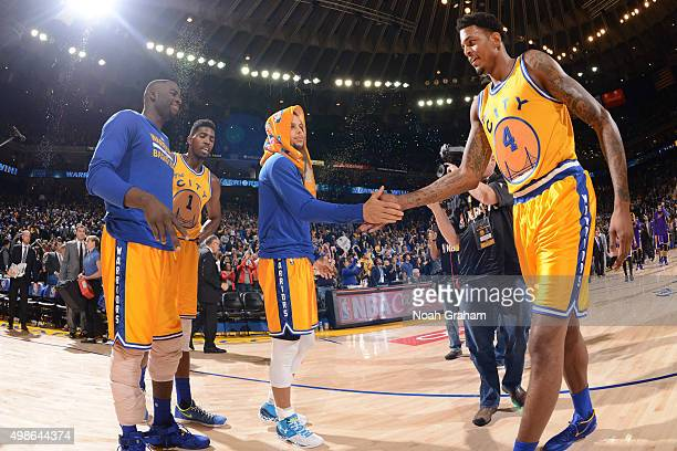 Stephen Curry high fives Brandon Rush of the Golden State Warriors after the team wins their 16th game in a row against the Los Angeles Lakers...