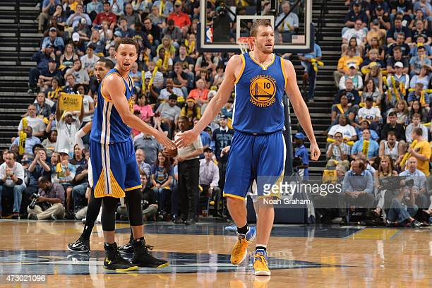 Stephen Curry high fives David Lee of the Golden State Warriors during Game Four of the Western Conference Semifinals against the Memphis Grizzlies...
