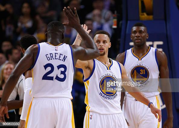 Stephen Curry highfives Draymond Green of the Golden State Warriors during their game against the San Antonio Spurs at ORACLE Arena on January 25...