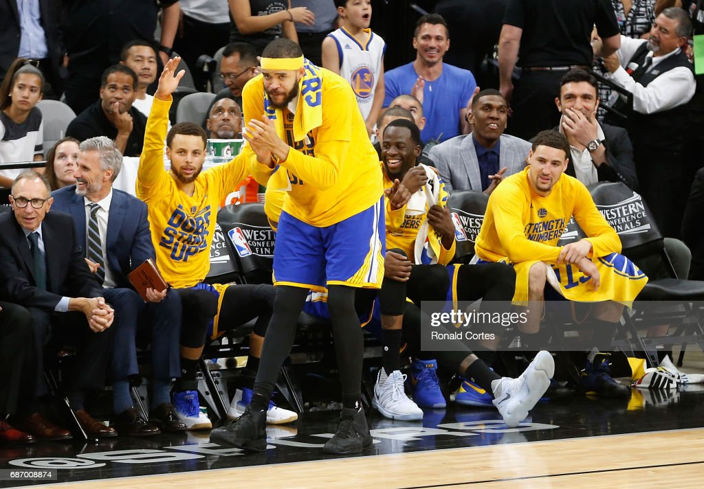 Stephen Curry #30, JaVale McGee #1, Draymond Green #23 and Klay Thompson #11 of the Golden State Warriors react on the bench in the second half against the San Antonio Spurs during Game Four of the 2017 NBA Western Conference Finals at AT&T Center on May 22, 2017 in San Antonio, Texas.