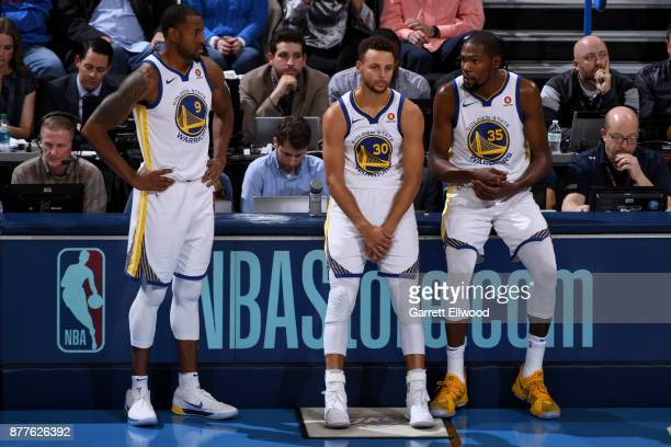 Stephen Curry Kevin Durant and Andre Iguodala of the Golden State Warriors look on during the game against the Oklahoma City Thunder at the...