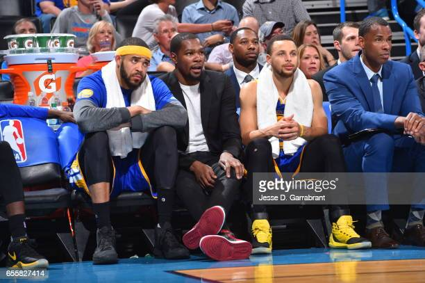 Stephen Curry Kevin Durant and JaVale McGee of the Golden State Warriors look on against the Oklahoma City Thunder during the game on March 20 2017...