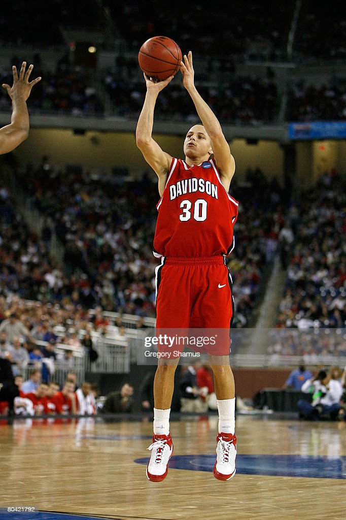 Stephen Curry of the Davidson Wildcats attempts a shot against the Wisconsin Badgers during the Midwest Regional Semifinal of the 2008 NCAA Division...