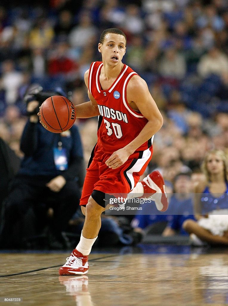 Stephen Curry of the Davidson Wildcats brings the ball up court against the Kansas Jayhawks during the Midwest Regional Final of the 2008 NCAA...