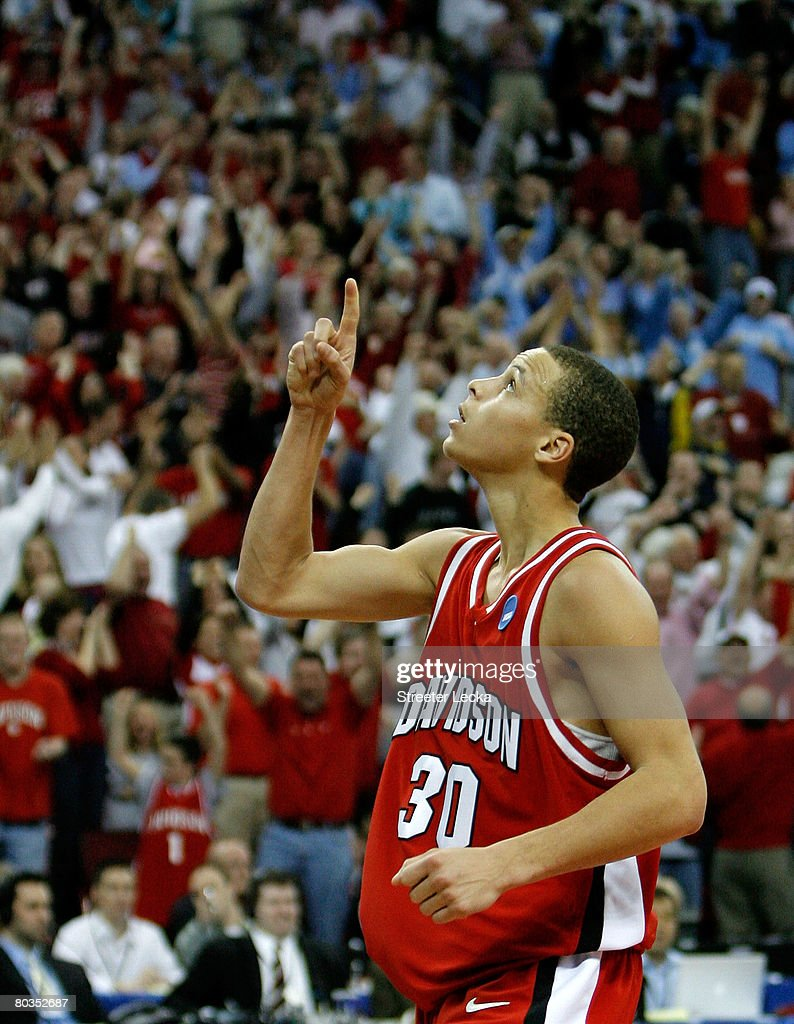 Stephen Curry #30 of the Davidson Wildcats celebrates a basket against the Georgetown Hoyas during the second round of the 2008 NCAA Men's Basketball Tournament Midwest Regionals on March 23, 2008 at RBC Center in Raleigh, North Carolina.