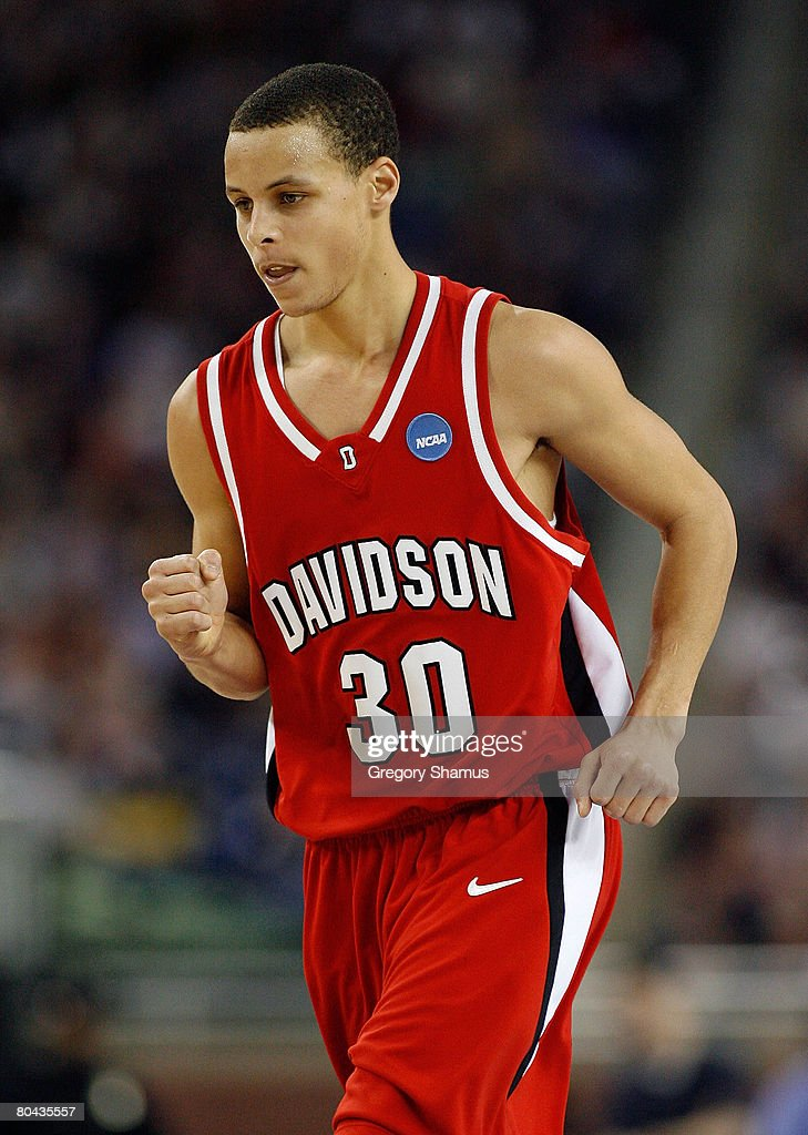 Stephen Curry of the Davidson Wildcats reacts after he made a basket against the Kansas Jayhawks during the Midwest Regional Final of the 2008 NCAA...